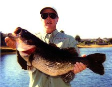 Captain Jackson with his 15lb 8oz Kissimmee bass fishing monster